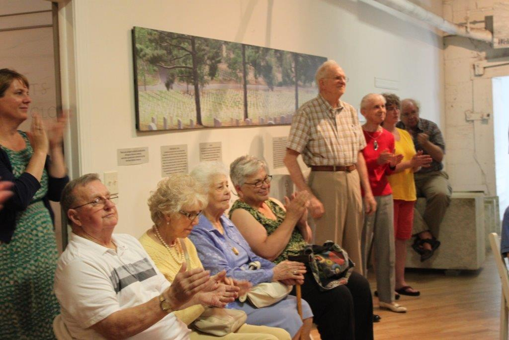 Proctor community members learn about student exhibit